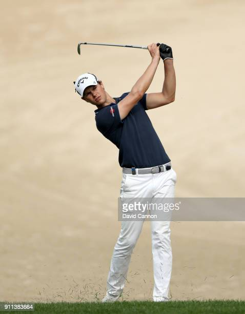 Thomas Detry of Belgium plays his second shot on the par 4 14th hole during the final round of the Omega Dubai Desert Classic on the Majlis Course at...