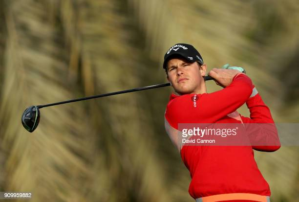 Thomas Detry of Belgium plays his tee shot on the par 5 third hole during the first round of the Omega Dubai Desert Classic on the Majlis Course at...