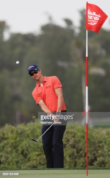 Thomas Detry of Belgium plays his third shot on the first hole during the final round of the Abu Dhabi HSBC Golf Championship at Abu Dhabi Golf Club...
