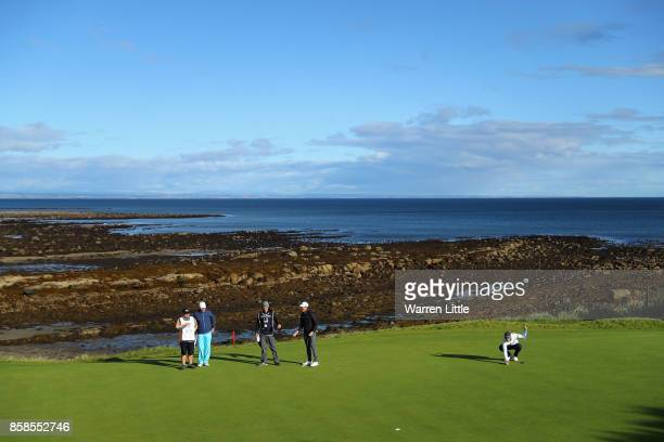 Thomas Detry of Belgium putts out on the 12th during day three of the 2017 Alfred Dunhill Championship at Kingsbarns on October 7 2017 in St Andrews...
