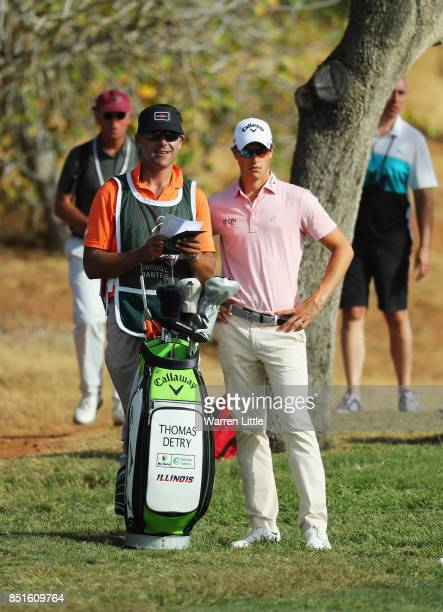 Thomas Detry of Belgium talks with his caddie on the 3rd hole during day two of the Portugal Masters at Dom Pedro Victoria Golf Club on September 22...