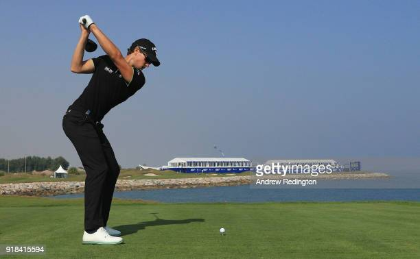 Thomas Detry of Belgium tees off on the par four 18th hole during the first round of the NBO Oman Open at Al Mouj Golf on February 15 2018 in Muscat...