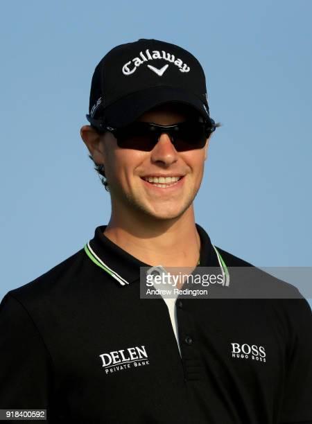 Thomas Detry of Belgium watches his tee shot on the par five 12th hole during the first round of the NBO Oman Open at Al Mouj Golf on February 15...