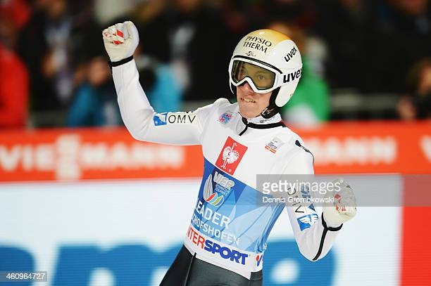 Thomas Diethart of Austria celebrates after winning the 62nd Four Hills Tournament at PaulAuflerleitnerSchanze on January 6 2014 in Bischofshofen...