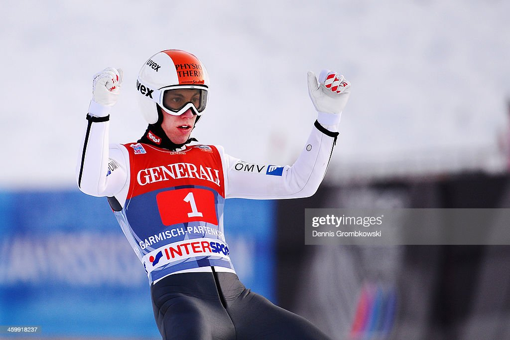 Thomas Diethart of Austria celebrates after winning the Four Hills Tournament event at Olympia Skistadion on January 1, 2014 in Garmisch-Partenkirchen, Germany.