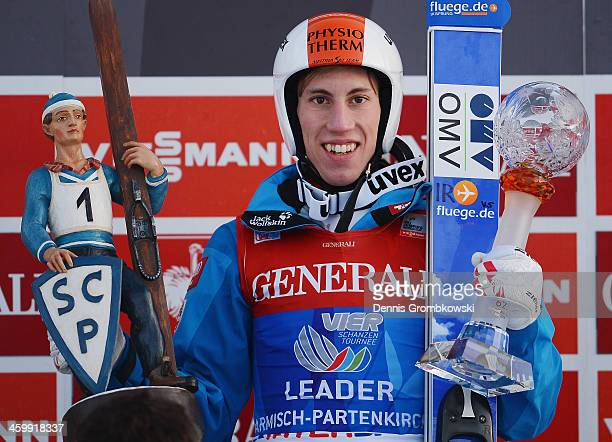 Thomas Diethart of Austria celebrates after winning the Four Hills Tournament event at Olympia Skistadion on January 1 2014 in GarmischPartenkirchen...