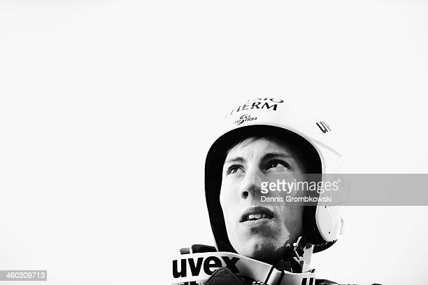 Thomas Diethart of Austria reacts after his qualification jump on day 1 of the Four Hills Tournament event at Bergisel on January 3 2014 in Innsbruck...