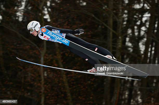 Thomas Diethart of Austria soars through the air during day 2 of the 62nd Four Hills Tournament event at PaulAuflerleitnerSchanze on January 6 2014...
