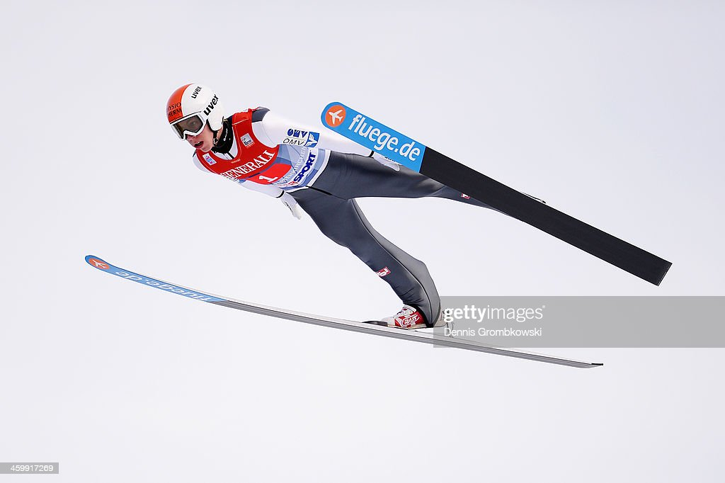 Thomas Diethart of Austria soars through the air during his first leg jump at Olympia Skistadion on January 1, 2014 in Garmisch-Partenkirchen, Germany.