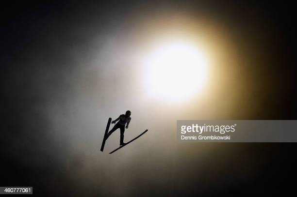 Thomas Diethart of Austria soars through the air during his qualification jump on day 1 of the 62nd Four Hills Tournament event at...