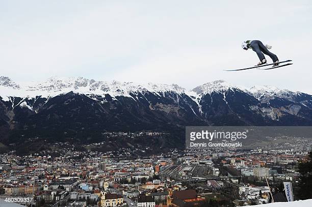 Thomas Diethart of Austria soars through the air during his second training jump on day 1 of the Four Hills Tournament event at Bergisel on January 3...