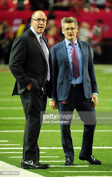 Thomas Dimitroff general manager for the Atlanta Falcons speaks to his assistant general manager Scott Pioli prior to the game against the Tampa Bay...