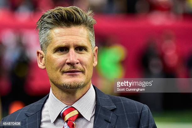 Thomas Dimitroff general manager of the Atlanta Falcons stands on the field in the second half against the New Orleans Saints at the Georgia Dome on...