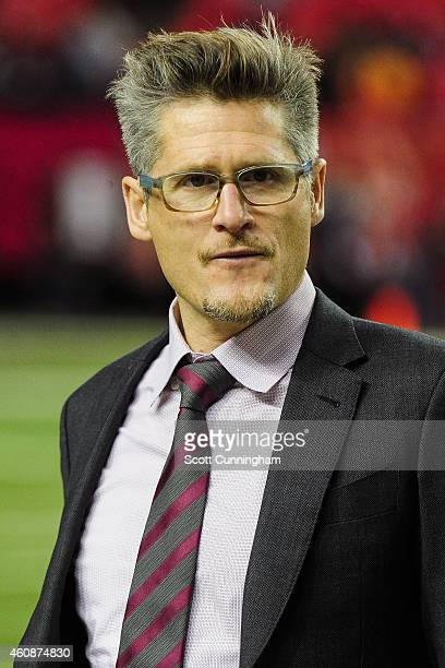 Thomas Dimitroff general manager of the Atlanta Falcons stands on the firld prior to the game against the Carolina Panthers at the Georgia Dome on...