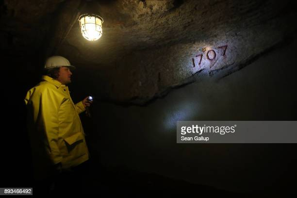 Thomas Dittrich a geologist working for Deutsche Lithium GmbH points to the date 1707 hewn by miners as he walks through a centuriesold former tin...