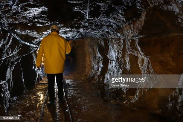 Thomas Dittrich a geologist working for Deutsche Lithium GmbH walks through a shaft rich in Zinnwaldite a silicate mineral that contains lithium in a...