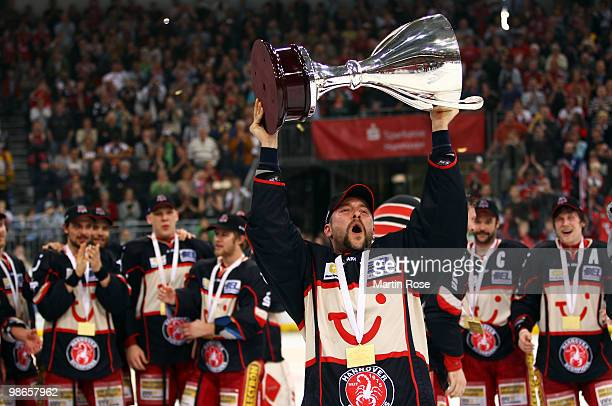 Thomas Dolak of Hannover celebrates with the trophy after winning the DEL play off final match between Hannover Scorpions and Augsburger Panther at...