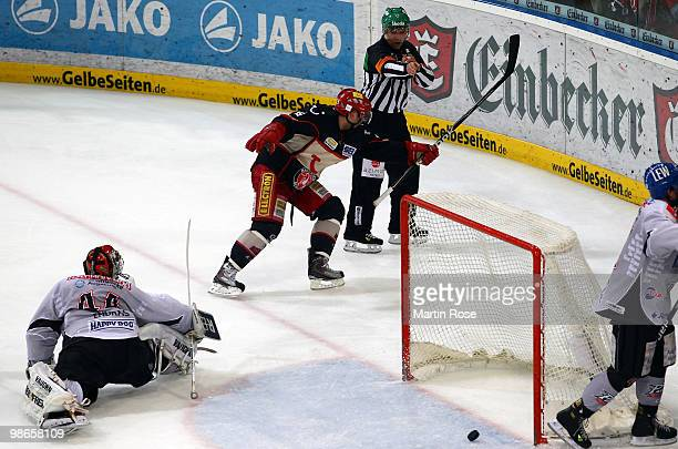 Thomas Dolak of Hannover scores his team's winning goal during the DEL play off final match between Hannover Scorpions and Augsburger Panther at TUI...