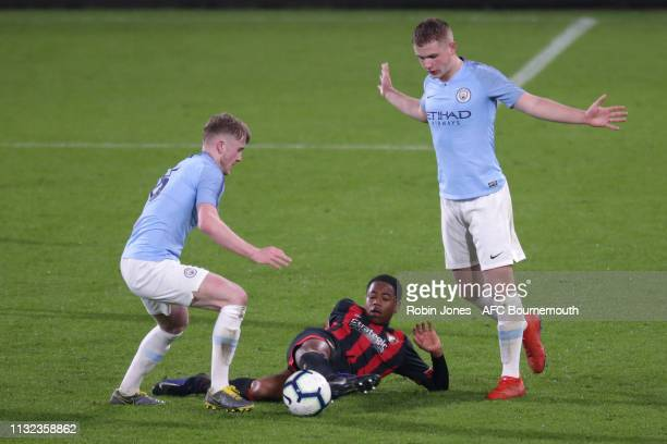Thomas Doyle and Rowan McDonald of Manchester City compete for the ball with Nathan MoriahWelsh of Bournemouth during the FA Youth Cup match between...