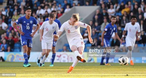 Thomas Doyle of England scores from the penalty spot during the UEFA European Under-17 Championship Group Stage match between England and Israel at...
