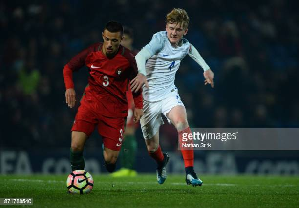 Thomas Doyle of England U17s and Tiago Manuel Maio Matos of Portugal 17s in action during the International Match between England U17 and Portugal...