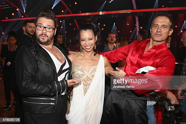 Thomas Drechsel MinhKhai PhanThi and Ralf Bauer smile during the final show of the television competition 'Let's Dance' on June 5 2015 in Cologne...