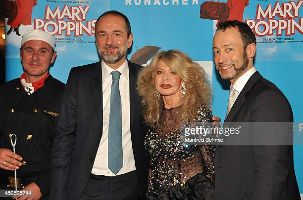 Thomas Drozda, Jeannine Schiller and Christian Struppeck pose for a photograph during the Mary Poppins musical premiere at Ronacher Theater on...