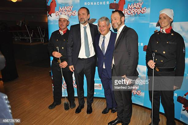 Thomas Drozda Sir Cameron Mackintosh and Christian Struppeck pose for a photograph during the Mary Poppins musical premiere at Ronacher Theater on...