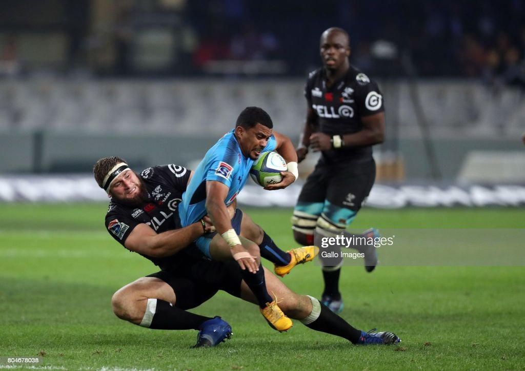 Thomas du Toit of the Cell C Sharks tackling Rudy Paige of the Vodacom Bulls during the Super Rugby match between Cell C Sharks and Vodacom Bulls at Growthpoint Kings Park on June 30, 2017 in Durban, South Africa.