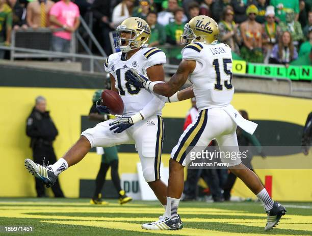 Thomas Duarte of the UCLA Bruins celebrates a touchdown against the Oregon Ducks with teammate Devin Lucien on October 26 2013 at the Autzen Stadium...