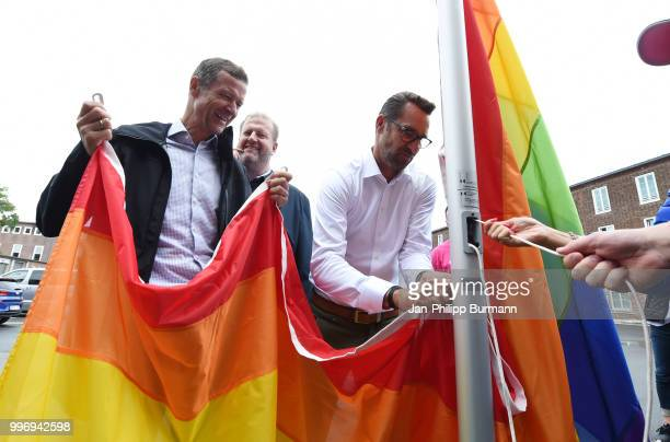 CEO Thomas E Herrich CEO Ingo Schiller and CEO Michael Preetz of Hertha BSC raise a rainbow flag in front of the office of Hertha BSC on july 12 2018...