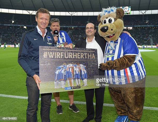CEO Thomas E Herrich Stadionsprecher Fabian of Wachsmann and mascot Herthinho of Hertha BSC during the game between Hertha BSC and Werder Bremen on...