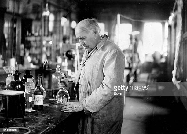 Thomas Edison American inventor in his chemistry laboratory 1917