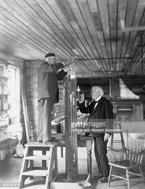 Thomas Edison and friend Francis Jehl rehearse for a reenactment of the first illumination of the incandescent lamp in 1929 50 years after the...