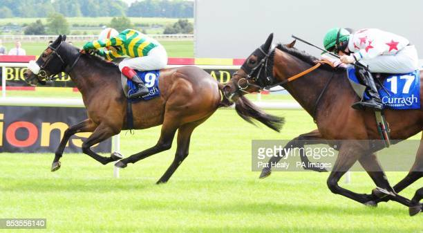 Thomas Edison and jockey Fran Berry win the Irish Daily Mail Handicap from Mindy during the Guineas Spring Festival at The Curragh Racecourse Co...