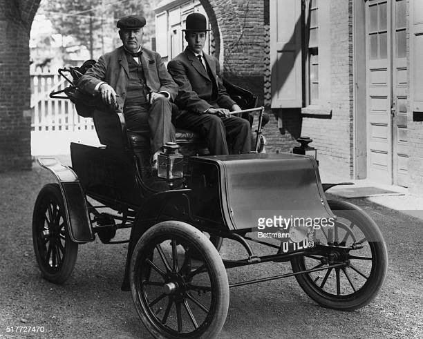 Thomas Edison gets a lift from his son Thomas Edison Jr in an electric automobile