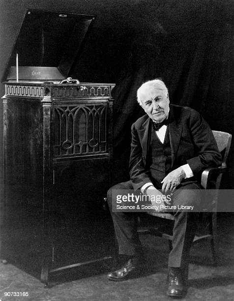 Thomas Edison is depicted here in old age seated next to an 1889 'Edison' brand phonograph Edison was a prolific American inventor who registered...