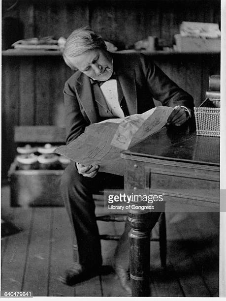 Thomas Edison Reading Newspaper