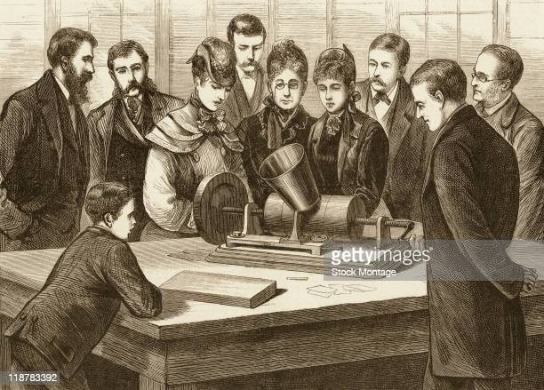 Thomas Edison shows one of his inventions, a phonograph, to people visiting his laboratory in Menlo Park, New Jersey. The picture was published in...