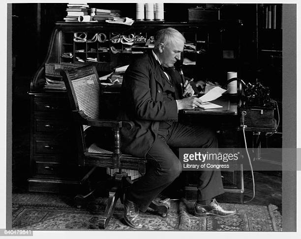 Thomas Edison sits at a desk stuffed with papers using a dictating machine in 1914 Edison had orginally marketed the phonograph as a dictating...