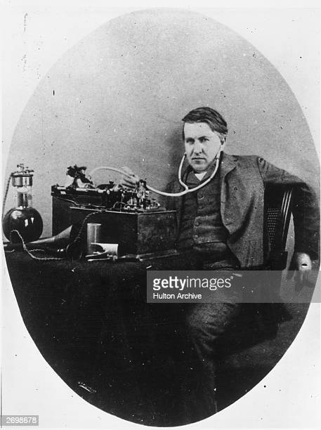 Thomas Edison the inventor and physicist with his phonograph