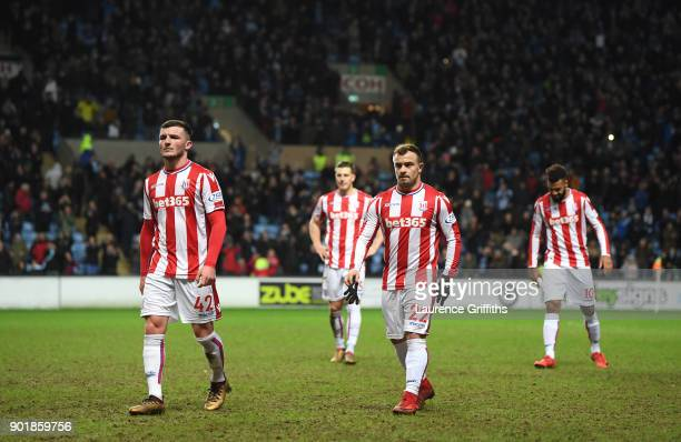 Thomas Edwards and Xherdan Shaqiri of Stoke City leave the field dejected after The Emirates FA Cup Third Round match between Coventry City and Stoke...
