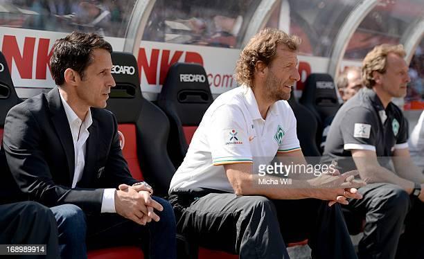 Thomas Eichin of Bremen caretaker manager Wolfgang Rolff of Bremen and caretaker manager Mathias Hoenerbach of Bremen look on during the Bundesliga...