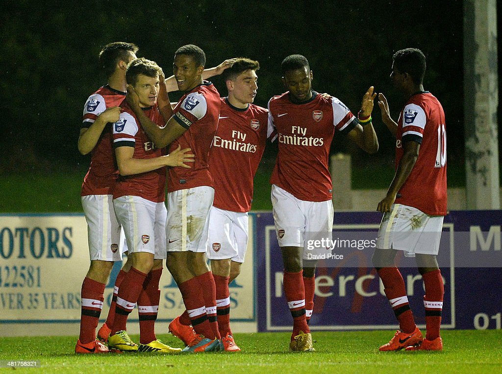 Thomas Eisfeld celebrates scoring Arsenal's goal with his team mates during the match between Bolton Wanderers U21 and Arsenal U21 in the Barclays Premier U21 League on March 31, 2014 in Lancaster, England.