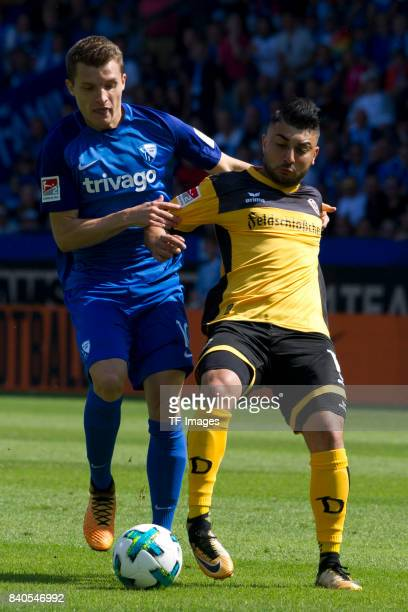 Thomas Eisfeld of Bochum and Aias Aosman of Dresden battle for the ball during the Second Bundesliga match between VfL Bochum 1848 and SG Dynamo...