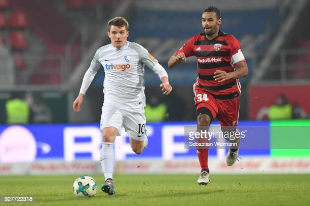 Thomas Eisfeld of Bochum and Marvin Matip of Ingolstadt run after the ball during the Second Bundesliga match between FC Ingolstadt 04 and VfL...