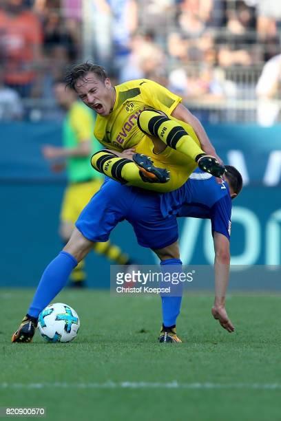 Thomas Eisfeld of Bochum challenges Felix Passlack of Dortmund during the preseason friendly match between VfL Bochum and Borussia Dortmund at...