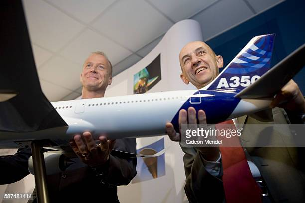 Thomas Enders and Louis Gallois the two CEOs of EADS pose with a model of the Airbus A350 prior to a press conference at the Farnborough Airshow...