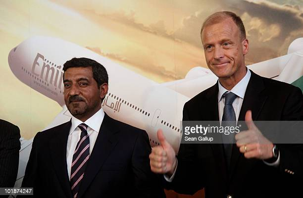 Thomas Enders CEO of European aircraft manufacturer Airbus gestures while posing with Sheikh Ahmed bin Saeed Al Maktoum Chairman of Emirates airline...