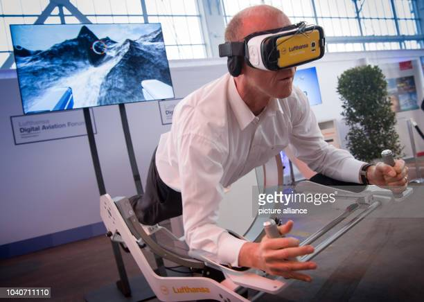 Thomas Enders Chairman of the Board of the Airbus Group using a digital flight simulator before the christening event of the new Lufthansa Airbus...